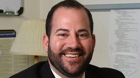 Michael Quinn of Massapequa as been hired as