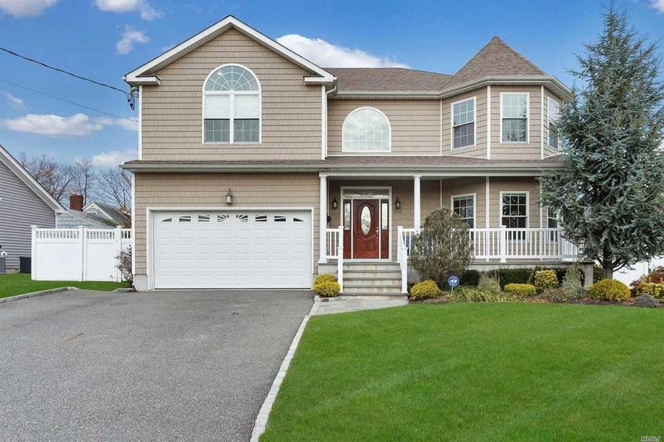 This Plainview Colonial includes four bedrooms and 2