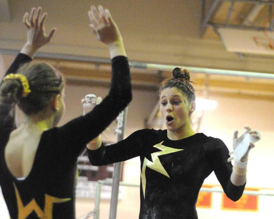 Alyssa Burns of Commack, right, gets congratulated by