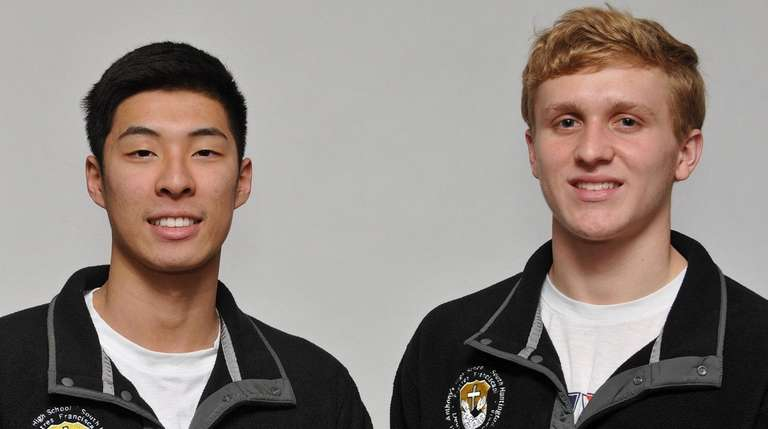 St. Anthony's boys swimmers Michael Chang, left, and