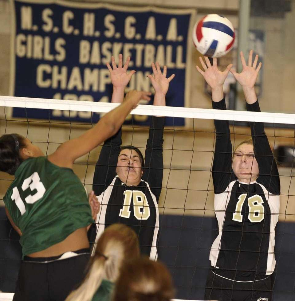 St. Anthony's Mariel Metalios, center, and Christina Sharkey,
