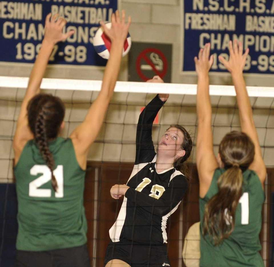 St. Anthony's Stephanie Sheehan volleys the ball past