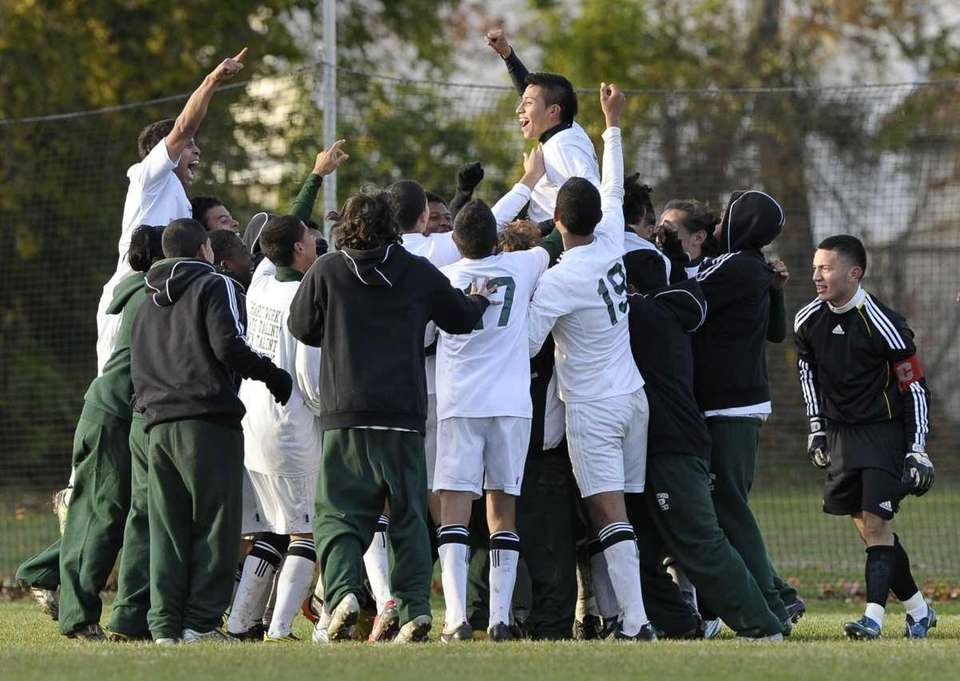 Brentwood teammates with Giancarlo Luna, top right, celebrate
