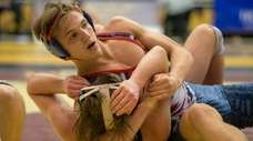 South Side's Kyle Mosher wrestles against MacArthur's Christian