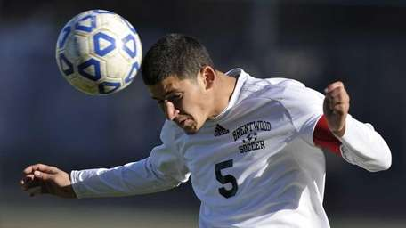 Brentwood's Irvin Flores heads the ball. (November 9,