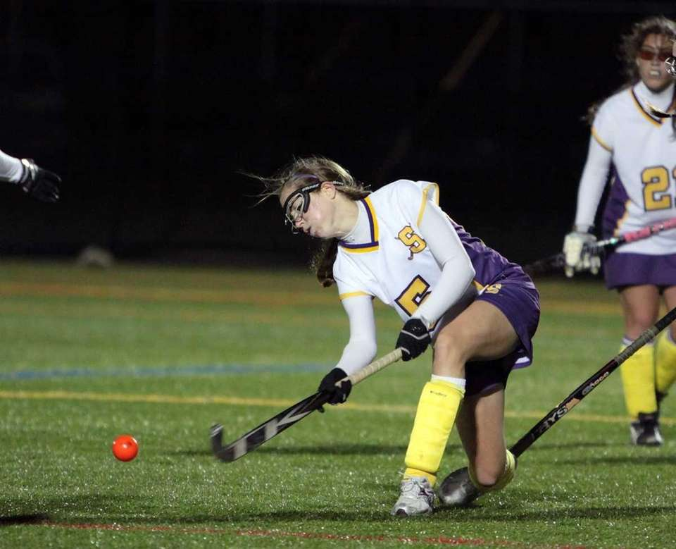 Sayville's Taylor Mills takes a shot against Shoreham-Wading