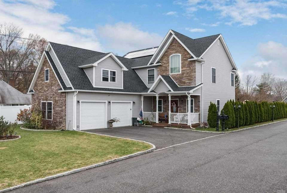 This Levittown Colonial includes four bedrooms and 2