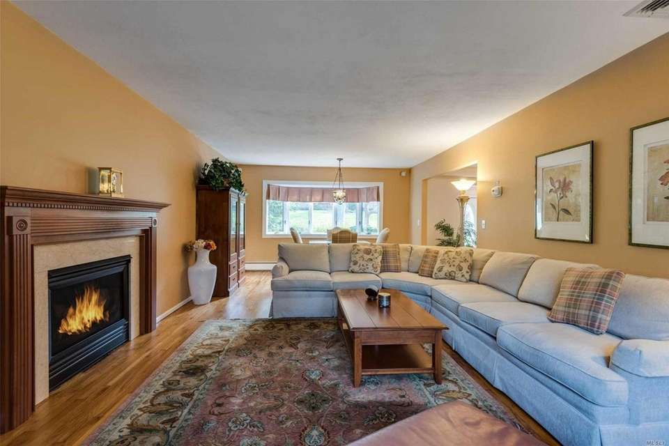 The main level includes living and dining rooms,