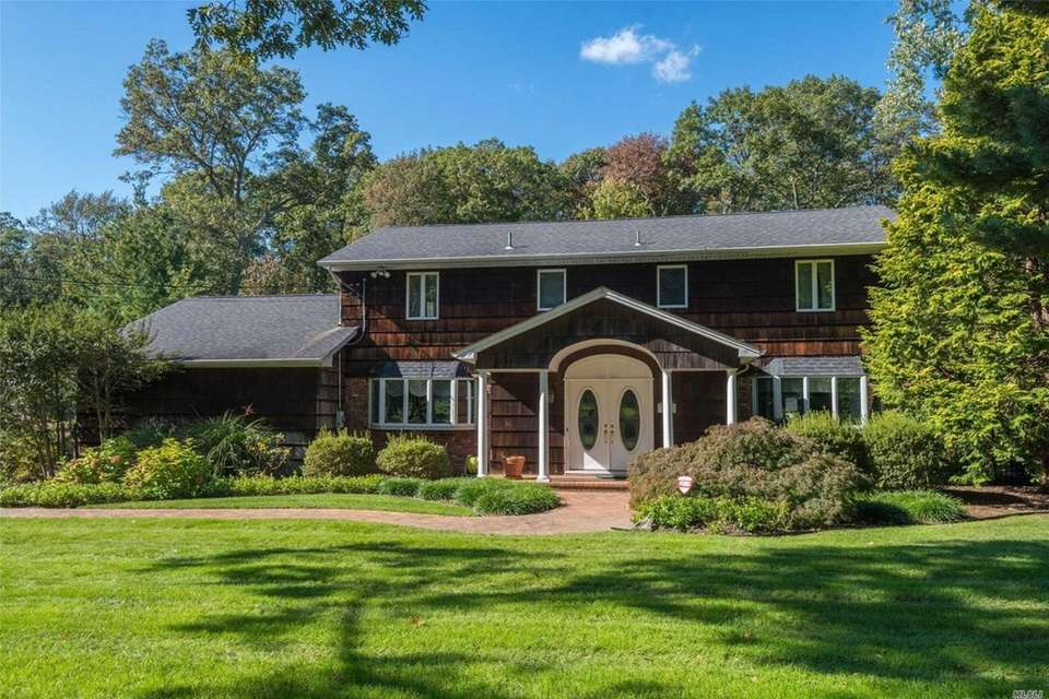 This Dix Hills Colonial features five bedrooms and