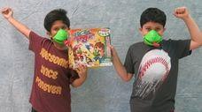 Kidsday reporters Arik Alif, left, and Muzammil Fayaz
