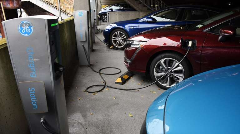 Electric cars are hooked up to one of