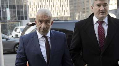 Alain Kaloyeros, left, arrives for his sentencing at