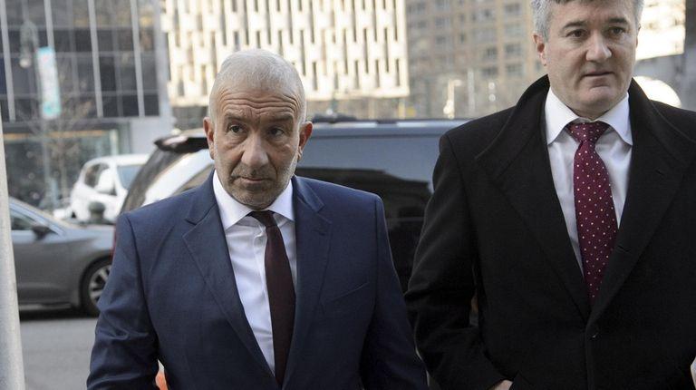 Alain Kaloyeros, left, arrives for his sentencing at