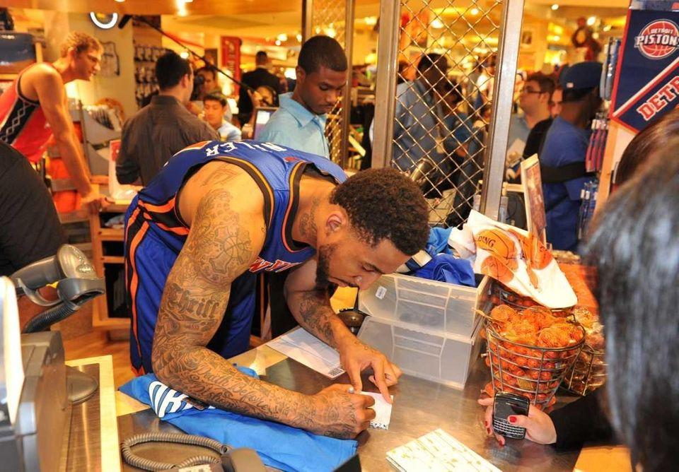 New York Knicks forward Wilson Chandler (21) signs