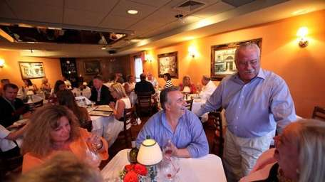 Owner Luigi Quarta chats with the customers at