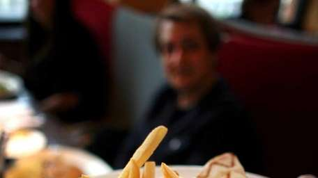 A wrap with french fries at Grand Lux