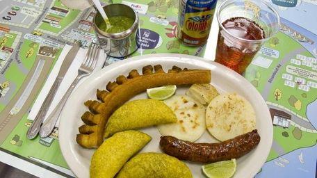 A mixed plate of fried pork skin, empanada