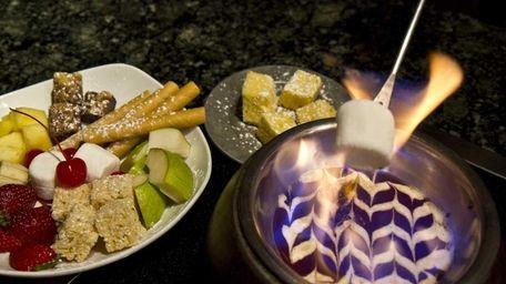 Chocolate Fondue can be flamb�ed to roast marshmallows