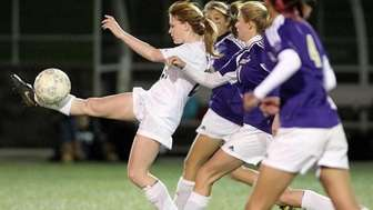 Sayville's Samantha Bishop controls the ball surrounded by