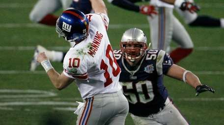 Giants quarterback Eli Manning releases a pass as