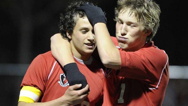 Friends Academy's Colin Heffron, right, congratulates Matt Slotnick,