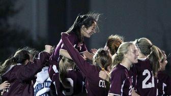 Garden City's Jill Yoo is carried on team's
