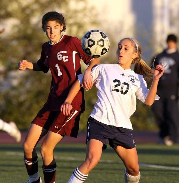 Garden City's Courtney Studdert challenges South Side's Christina