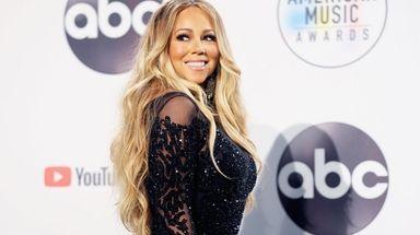Mariah Carey poses in the press room