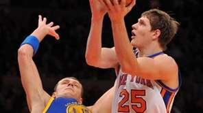 New York Knicks' Timofey Mozgov (25) is fouled