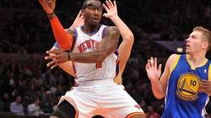 New York Knicks' Amar'e Stoudemire (1) looks to