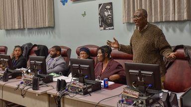 Wyandanch school board member Charlie B. Reed speaks