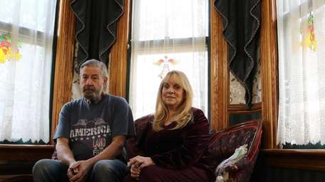 Tom and Gilda Gricka sit inside their 1882