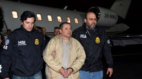 "Joaquin ""El Chapo"" Guzman Loera, center, is escoretd"
