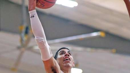 Long Island Lutheran's Andre Curbelo goes in for