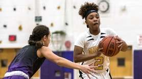 Uniondale's Kapri Bradshaw looks to pass as Greenport/Southold's