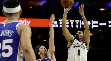 The Nets' Spencer Dinwiddie goes up for a