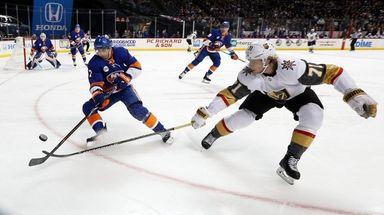 The Islanders' Jordan Eberle plays the puck against