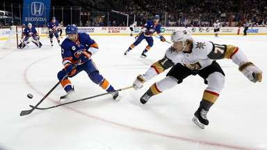 The Islanders' Jordan Eberle plays the puck against