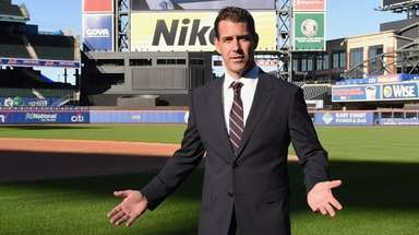 Mets general manager Brodie Van Wagenen stands on