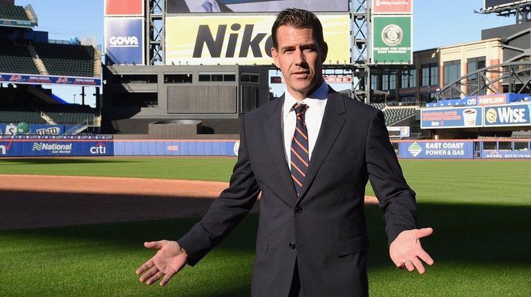 Mets general manager Brodie Van Wagenen stands on