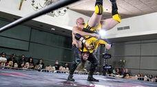 Evolve champion Fabian Aichner piledrives NXT's Kassius Ohno