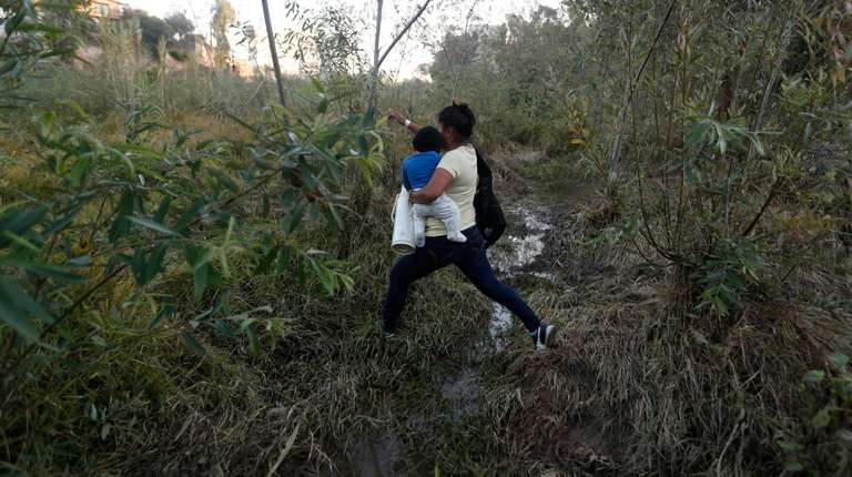 Yesenia Martinez, 24, carries her eight-month-old son Daniel
