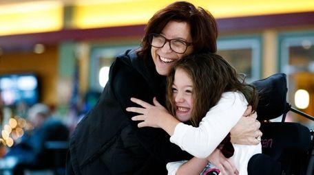 Gina Richardson hugs her daughter, Lauren, 8, during