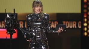Taylor Swift accepts the award for tour