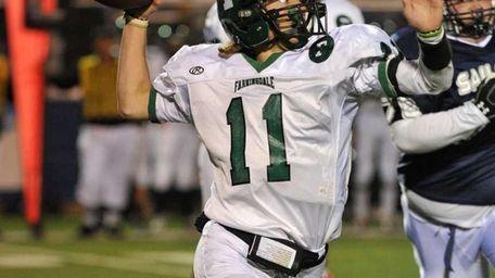 Farmingdale Dalers quarterback Sal Tuttle (11) drops back