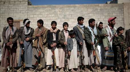Tribesmen loyal to Houthi rebels attend a gathering