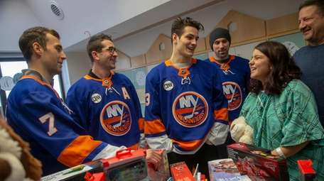 From left, Islanders players Jordan Eberle, Cal Clutterbuck,