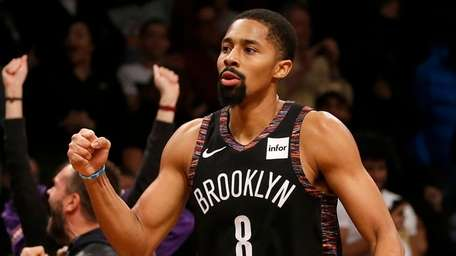 Spencer Dinwiddie #8 of the Nets reacts after