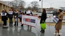 Physicians, parents and educators rallied outside the Suffolk