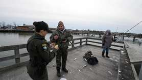State environmental conservation policemen patrol Long Island's shores